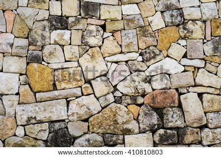 Stones wall texture. Facade of an old stone. Stone background. - stock photo