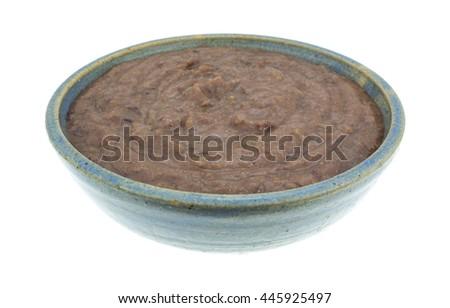 Stoneware bowl filled with black bean dip. - stock photo