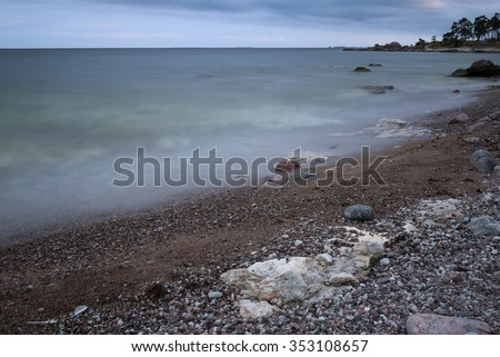 Stony beach on the island Gotland, Sweden, near the village Ljugarn at dawn.  Long time exposure  - stock photo