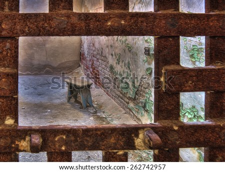 Stool in a Cell at Eastern State Penitentiary, Philadelphia, Pennsylvania - stock photo