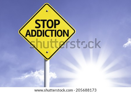 Stop Addiction road sign with sun background - stock photo