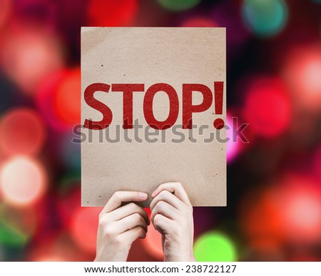 Stop! card with colorful background with defocused lights - stock photo