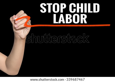 Stop Child Labor word write on black background by woman hand holding highlighter pen - stock photo