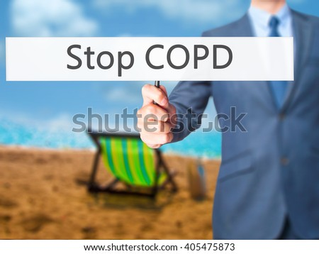 Stop COPD - Businessman hand holding sign. Business, technology, internet concept. Stock Photo - stock photo