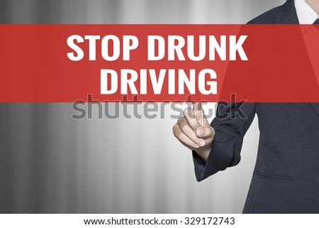 Stop Drunk Driving word on virtual screen push by business woman red tab - stock photo