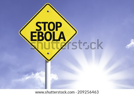 Stop Ebola road sign with sun background - stock photo