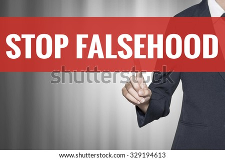 Stop Falsehood word on virtual screen push by business woman red tab - stock photo