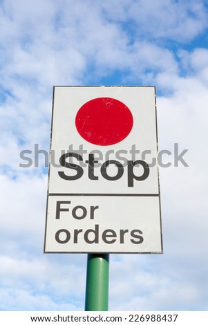 Stop for Orders railway sign instruction to train drivers. - stock photo