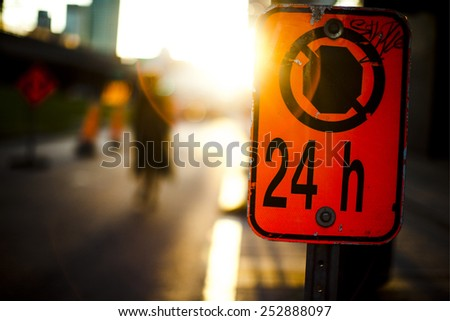 stop forbidden parking sign sunset 24 hours montreal city downtown no stops - stock photo