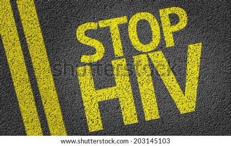 Stop HIV written on the road - stock photo