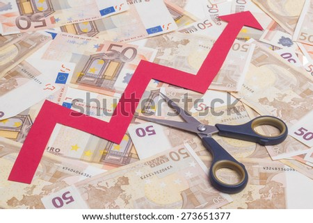 Stop increasing euro value concept. Scissor cutting growing arrow over fifty euro notes background - stock photo