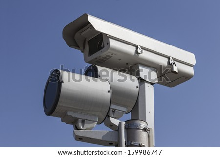 Stop light traffic camera with mounted strobe lights. - stock photo