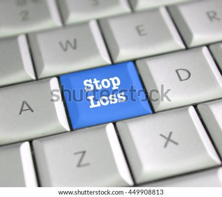 Stop loss computer key - stock photo