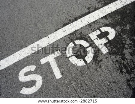 stop on pavement - stock photo