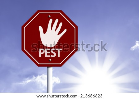 Stop Pest red sign with sun background  - stock photo