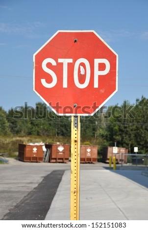Stop sign along sidewalk - stock photo