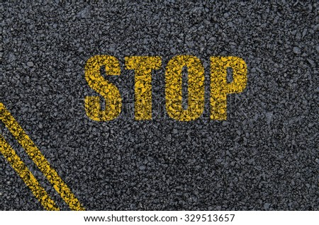 Stop sign background on asphalt with centre lines - stock photo