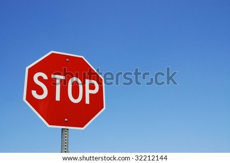 Stop sign blue sky background room for copy space - stock photo