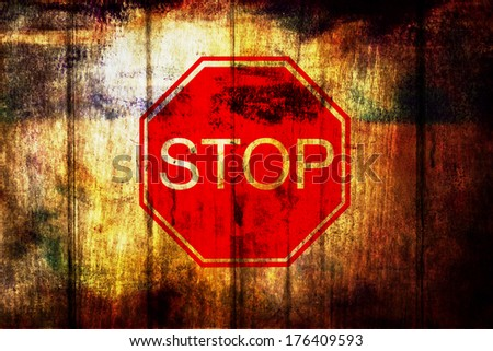stop sign on grunge wood background  - stock photo