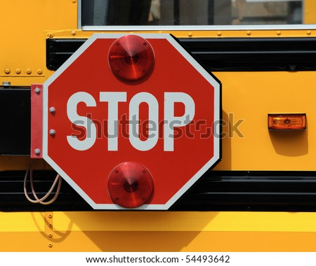 Stop sign on school bus - stock photo