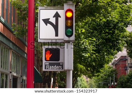 Stop sign traffic signal downtown street corner  - stock photo