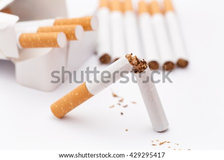 Stop Smoking! Conceptual image. Broken cigarette and pack of cigarettes. Close up. - stock photo