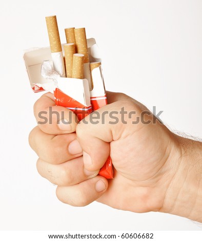 stop smoking fist with crushed pack of cigarettes - stock photo