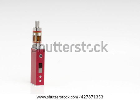 Stop smoking, start vaping. A red vape or electronic cigarette placed on the left on a shaded white background. Room for text on the right side. - stock photo