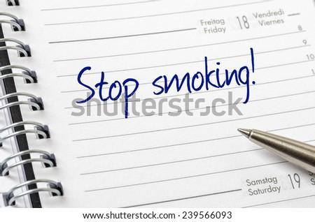 Stop smoking written on a calendar page - stock photo