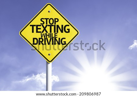 Stop Texting While Driving road sign with sun background - stock photo