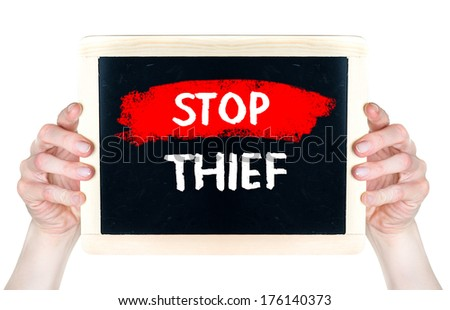 Stop thief . Creative composition with the message Stop thief woman hold on blackboard  - stock photo