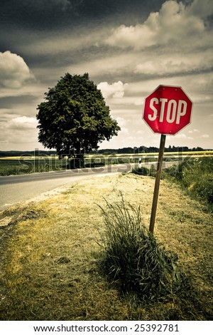 stop traffic sign in the nature - stock photo