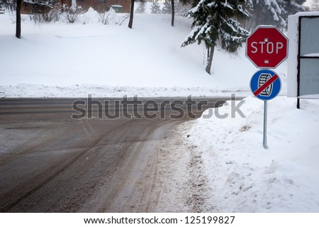 Stop using wheel chains road signs - stock photo