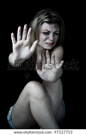 "STOP Violence With Women, Scared and beaten white woman holding out her hands in the ""STOP"" position - stock photo"