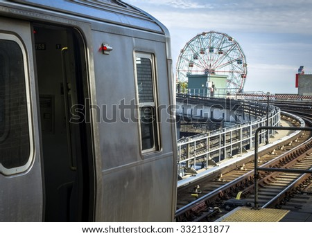 Stopped train in an elevated subway station overlooking Coney Island in Brooklyn, New York - stock photo