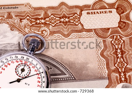 Stopwatch and a Stock Certificate - Market Timing Concept - stock photo