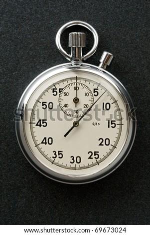 Stopwatch isolated on dark - stock photo