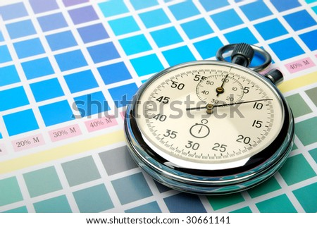 Stopwatch on a color chart - stock photo