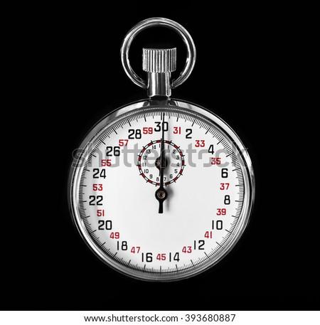 Stopwatch on black background - stock photo