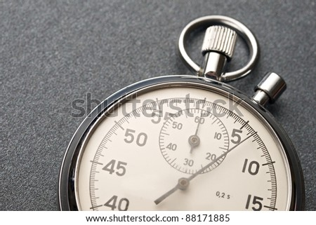 Stopwatch on the grey background - stock photo