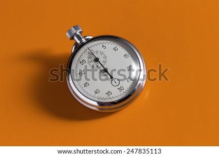 stopwatch on the orange background - stock photo