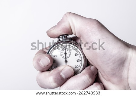 Stopwatch with pressed button - stock photo