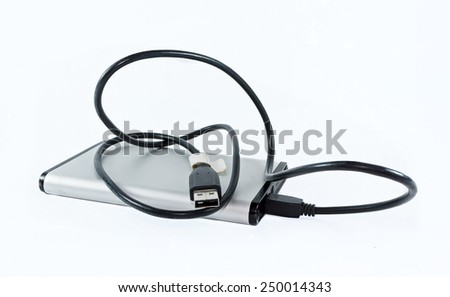 Storage device with connection cable on a white background - stock photo