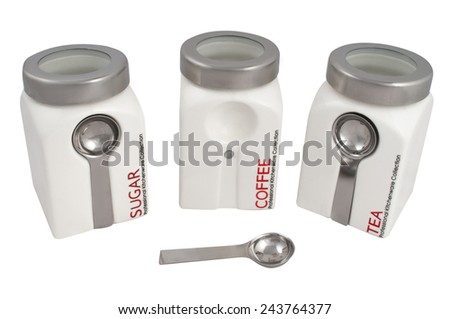 storage jars tea coffee sugar with a spoon isolated on white background - stock photo
