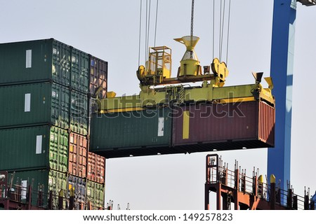 Storage of a container on the cargo liner - stock photo