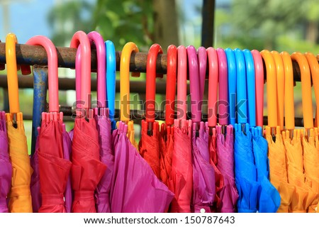 storage of different colors umbrella - stock photo