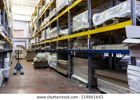 storage of goods in a modern warehouse - stock photo