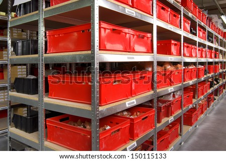 storage room with boxes and shelves - stock photo