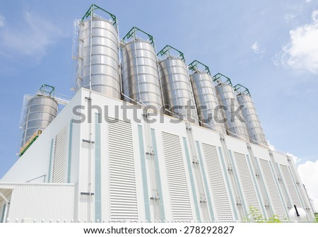 Storage silos in a chemical plant - stock photo