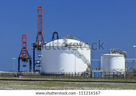 Storage tanks of factory for raw materials for synthetic foam and plastics. - stock photo